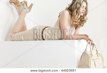 lying woman wearing summer clothes and shoes with a handbag