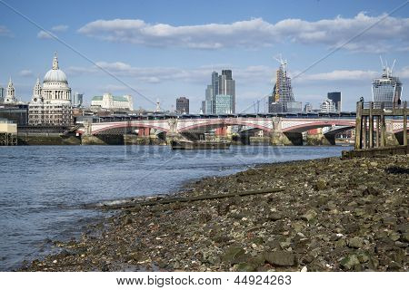 Low Tide River Thames And London City Skyline Including St Paul's Cathedral