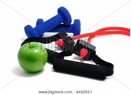 Resistance Band, Blue Weights, And Green Apple
