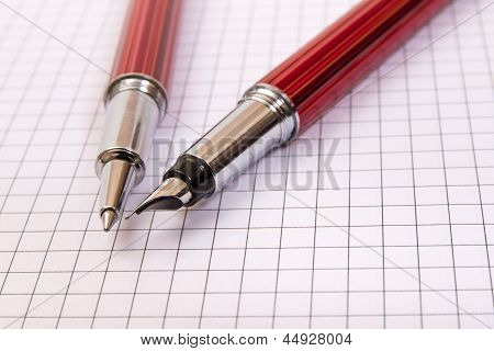 Two Pens On A Notebook Close Up