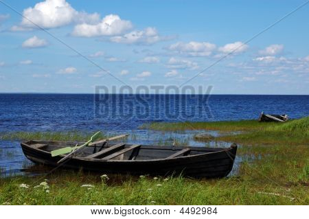 Old Wooden Fishing Boats On The Lake Bank 2