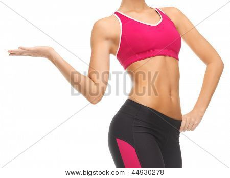 close up of woman with trained abs showing something