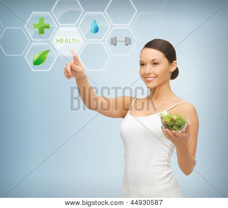 woman holding salad and working with menu on virtual screen