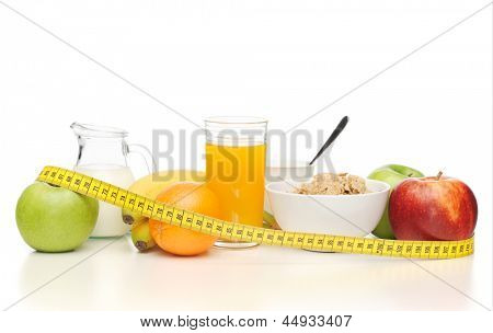 close up of healthy breakfast and measuring tape