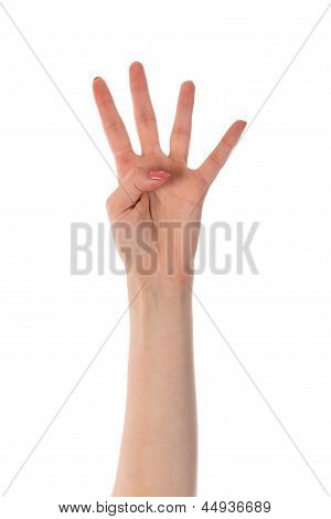 Female Hand Showing Four Fingers Isolated On White Background