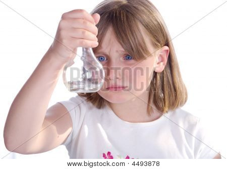 Girl Looking At Bottle