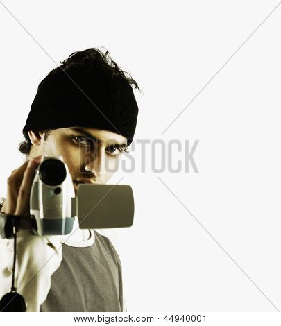 Portrait of man holding video camera