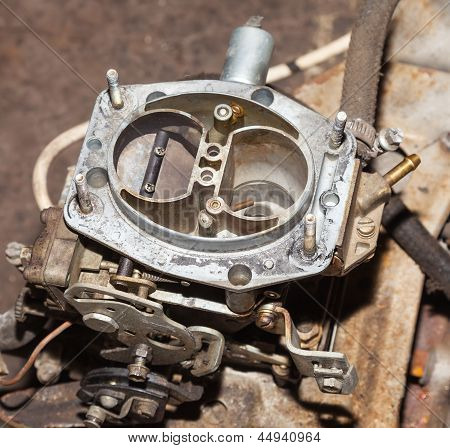 Car's Carburetor With The Cover Removed