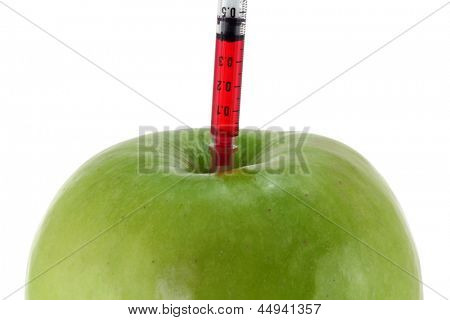 Conceptual photo of Genetic Modification - Red Liquid injecting to a Green Apple