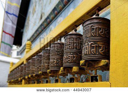 Prayer wheels at Bodhnath stupa in Kathmandu, Nepal