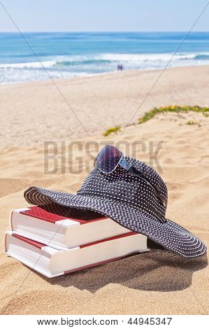 Panama For The Sun And Reading Books On The Beach Against The Sea. Sunglasses.