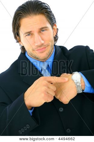 Upset Businessman Pointing At Watch