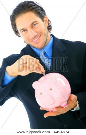 Young Businessman Saving Money