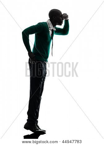 one african  black man standing tiptoe looking away   in silhouette studio on white background