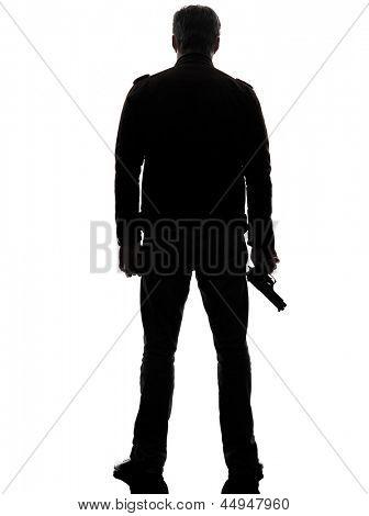 one man killer policeman holding gun silhouette rear view studio white background