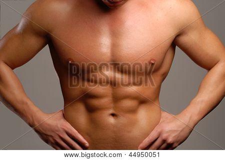 Shaped man abdominal muscle.