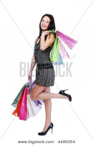 Laughing Woman Standing With Color Bags