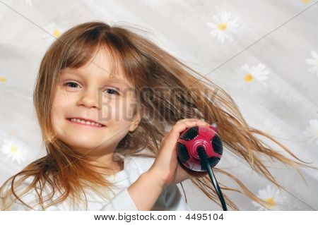 Girl Blowing Dry Her Hair