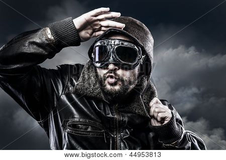 pilot with glasses and vintage hat with funny expression