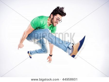Handsome Man Dressed Casual Jumping And Smiling  - Dynamic Wide Angle Shot