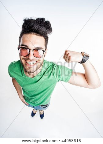 Funny Handsome Man With Hipster Glasses Showing Muscles - Wide Angle Shot