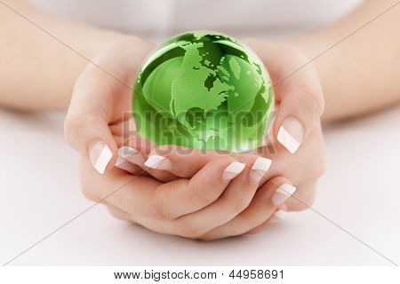 Globe in womans hands concept for protecting the earth and environmental conservation