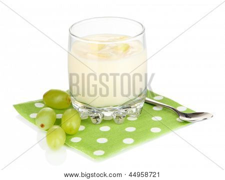Delicious yogurt in glass with grapes isolated on white