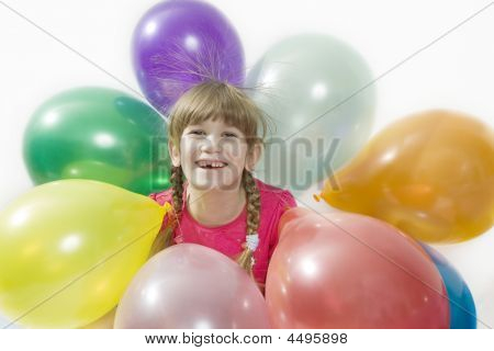 Little Happy Giggle Girl Sitting With Colour Balloons.