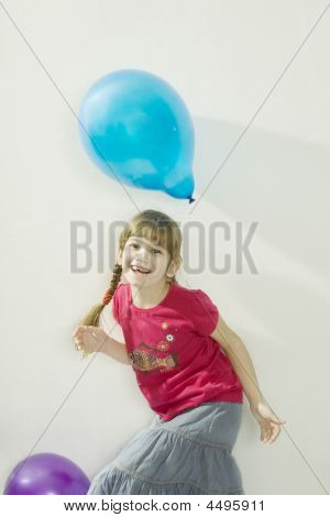 Young Happy Girl Playing With Colour Balloons