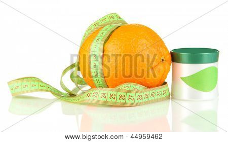 Orange with measuring tape and body cream, isolated on white