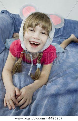 Little Girl Wearing Mouse`s Ears