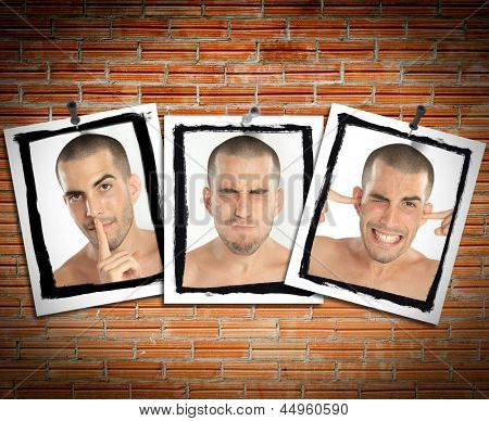 Succession of pictures posted on a brick wall of a young man mimicking see no evil, hear no evil, speak no evil