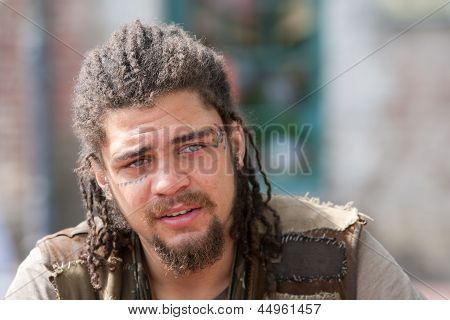 Portrait Rebel With Dreadlocks And Tattoos