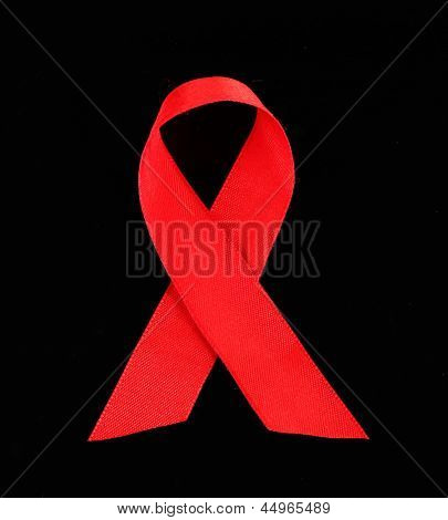 Red ribbon HIV, AIDS isolated on black