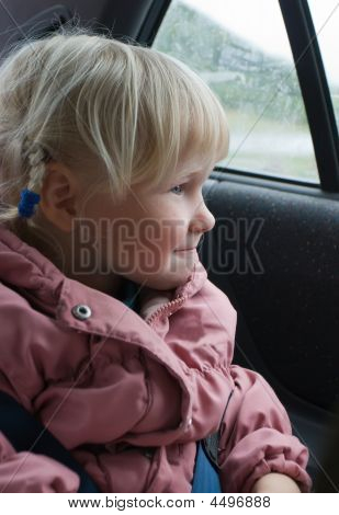 Little Girl Looks In Automobile Window