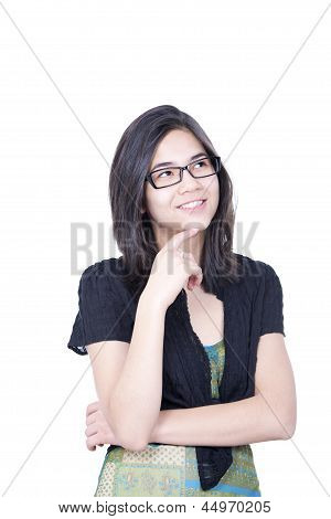 Smart Looking Young Biracial Teen Girl Looking Upward With Smiling, Inspired Expression
