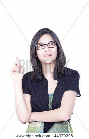 Young Biracial Teen Girl, Standing With Raised Finger Pointing To Sky, As If She Just Had A Great Id