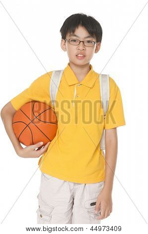 portrait of a child with backpack holding a ball isolated on white background