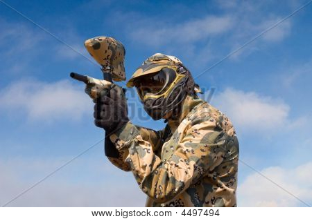 Paintball Player Over Sky Background