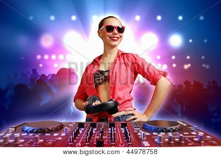 DJ with a mixer equipment to control sound and play music