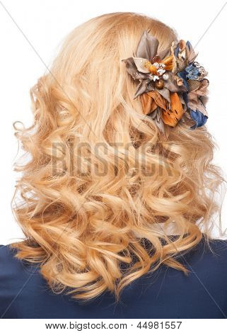 Woman with curly blond hair with beautiful hairstyle and stylish hair decoration. Isolated on white background