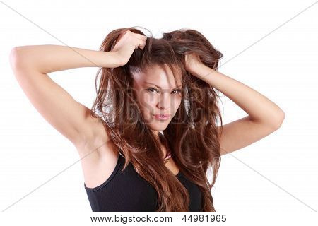 Young Brunette Woman Tears Her Hair And Looks At Camera Isolated On White Background.