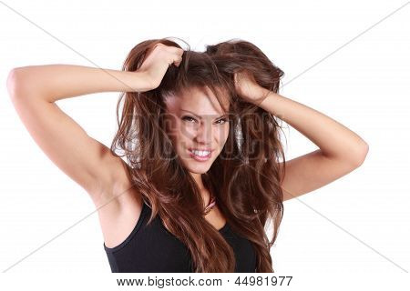 Young Angry Woman Tears Her Hair And Looks At Camera Isolated On White Background.