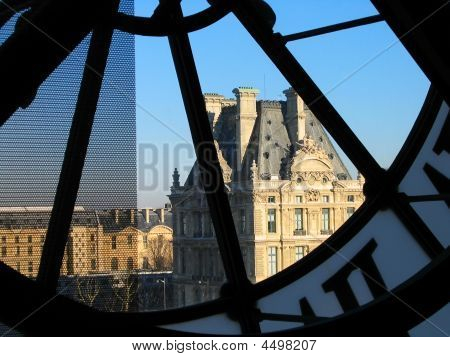 Tower Of Louvre Through Orsay Clock