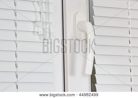 Handle white plastic windows with shutters