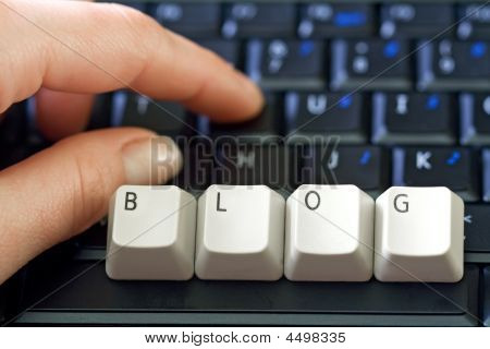 Hand And Laptop Keyboard