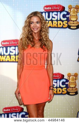 LOS ANGELES - APR 27:  Denise Richards arrives at the Radio Disney Music Awards 2013 at the Nokia Theater on April 27, 2013 in Los Angeles, CA