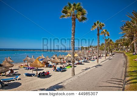 TENERIFE, SPAIN-SEPTEMBER 17:Beach Playa de la Vistas  on September 17, 2011Tenerife,Spain. More than 5 million tourists from UK visit Tenerife every year.