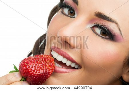Attractive Girl Eating Strawberry.