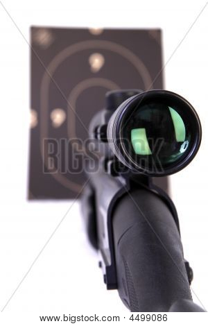 Shotgun With  Rifle-scope Pointing A Target